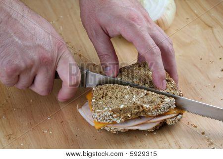 Hands Cutting Sandwich