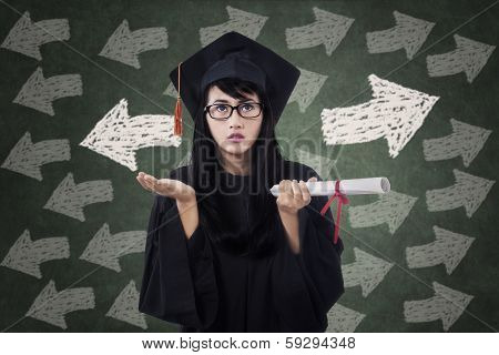 Confused Female Student In Graduation Gown