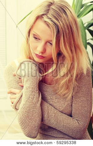 Emotional portrait of abused, beautiful, teen ,caucasian woman- violence concept, high emotional