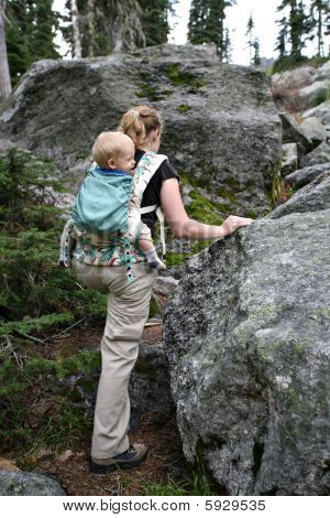 Mother And Child Hiking On Mountain Terrain