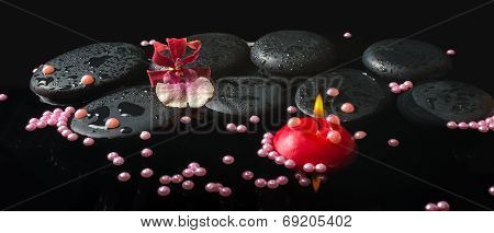 Spa Setting Of Orchid Cambria Flower And Pearl Beads, Zen Stones With Drops And Red Candles On Refle