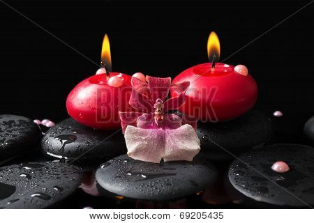 Spa Setting Of Red Candles On Zen Stones With Drops, Orchid Cambria Flower And Pearl Beads In Reflec
