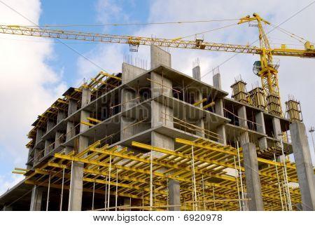 Crane Near Building On Cloudly Sky Horizontal