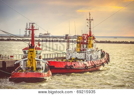 Red Boats In Sea Port Transport Strait Of Kerch In Crimea With Sunset Sky On Background