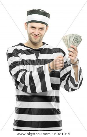 A prisoner with handcuffs holding US dollars