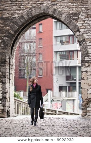 Woman Walking In Old City