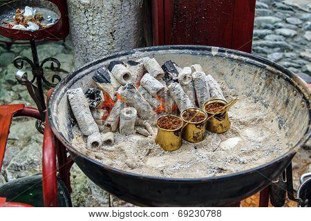Turkish coffee brewed on charcoal in traditional method Safranbolu Turkey poster