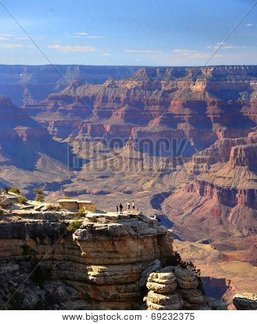 Human figures underscore the grandeur and size of the canyon, South rim of Grand Canyon, Arizona