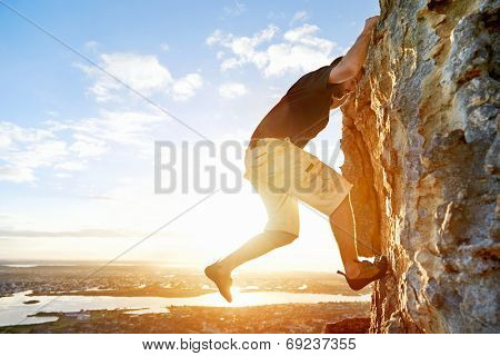 Man rock climbing up a steep mountain with copyspace
