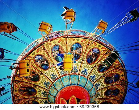 Instagram filtered image of an amusement park swing ride