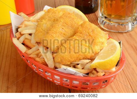 Fish And Fries On Newspaper