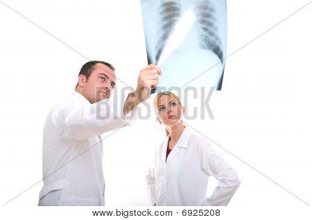 Medical team examining the xray film