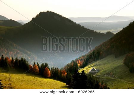 Mountain landscape of the Swiss Jura mountains with farm