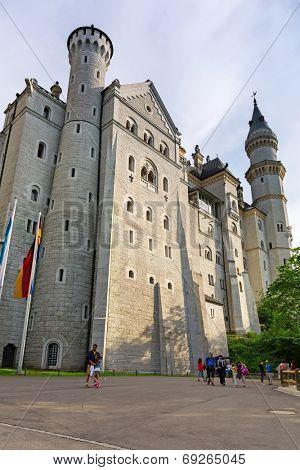 HOHENSCHWANGAU, GERMANY - 19 JUNE 2014: People outside of Neuschwanstein Castle in Hohenschwangau, Germany. Neuschwanstein castle is a nineteenth-century palace built for Ludwig II of Bavaria.