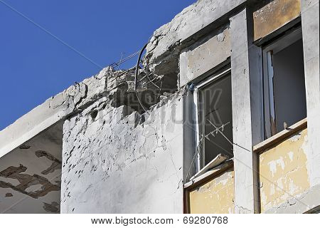 ASHKELON, ISRAEL - JANUARY 10, 2009: Hole in the roof,  broken windows and damaged apartment after direct hit and explosion caused by rocket launched by Hamas terrorists from Gaza strip.