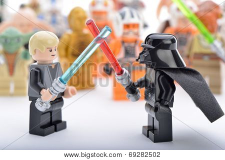 Ankara, Turkey - April 06, 2013: Lego Star Wars Darth Vader and Luke Skywalker are fighting with sword in front of Star Wars characters