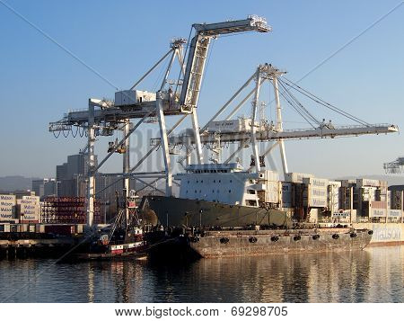 Matson Shipping Boat Is Unloaded By Cranes In Oakland Harbor