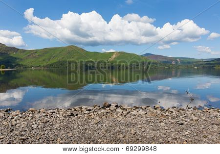 Derwent Water Lake District National Park Cumbria England uk south of Keswick blue sky on beautiful calm sunny summer day with reflections and clouds view towards catbells poster