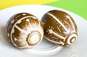 Handmade Easter eggs craft arranged on a white plate poster