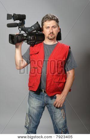 Cameraman in red vest
