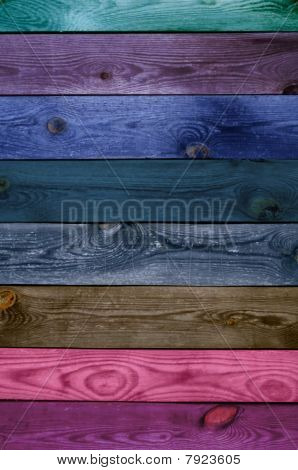 A multicolored wooden wall as a background poster