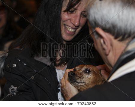 Rabbi Rubinstein cradles small dog