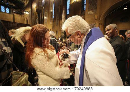 Pastor Stephen Bauman blessing dog