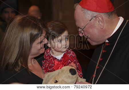 Cardinal Dolan blesses stuffed animal