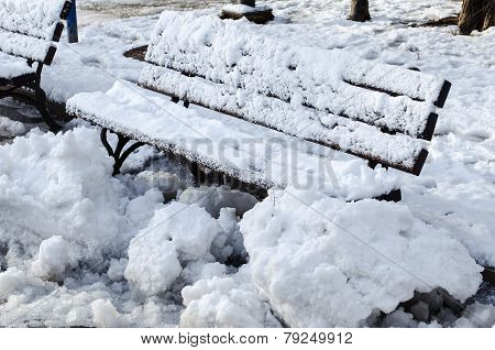 Wooden frosted bench in Russe Bulgaria closeup view poster