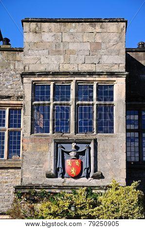Tissington Hall window and crest.