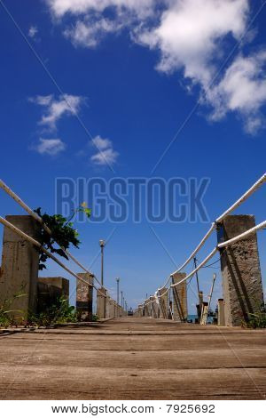 Blue sky over directional jetty