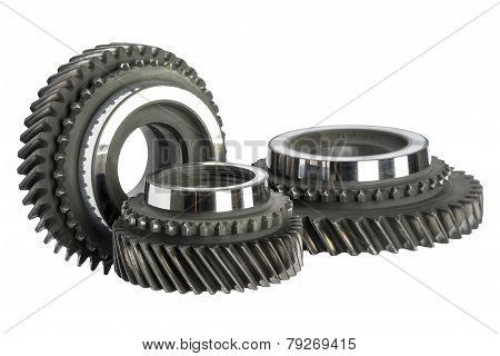 Three Worn Cog Wheels