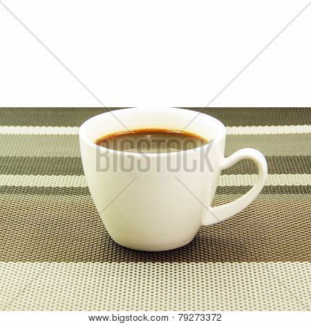 Espresso In White Cup On Tablemat