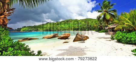 tropical holidays in Seychelles , panoramic view of Takamaka bea poster