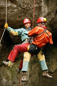 Cavers work out rescue operations in caves.Caver at work. poster