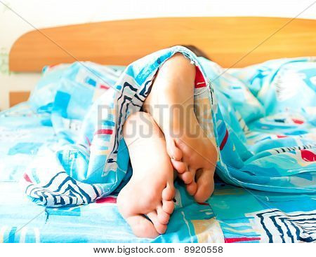 Sleeping woman's cute feet