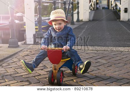 Cute Toddler On A Tricycle