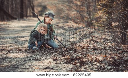 small children play in the woods, photo in vintage style