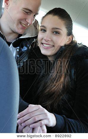 Young Couple Having Fun In Car