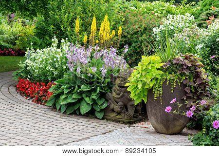 Detail of a beautiful summer garden with an interlocking stone walkway.
