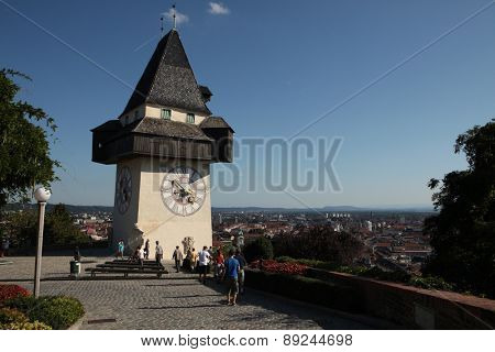 GRAZ, AUSTRIA - SEPTEMBER 3, 2011: People enjoy panoramic views from near the Uhrturm (Clock Tower) on the Grazer Schlossberg (Castle Hill) in Graz, Styria, Austria.