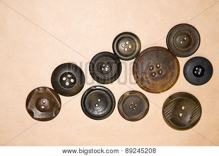 A Lot Of Vintage  Buttons  On The Craft Paper