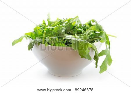 Rucola Or Arugula, Fresh Green Rocket Salad  In A White Bowl, Isolated