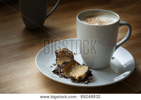 Coffee With Milk Foam And Cocoa And Marzipan In Dark Chocolate