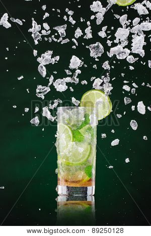 fresh mojito drink with liquid splash and drift, freeze motion. poster