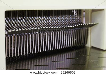 The image of a bread slicer in bakery