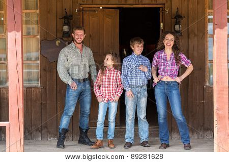 family of four posing on terrace of  wild west saloon