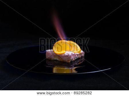 Orange dessert with fire