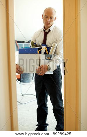 Young sad caucassian businessman lost his job