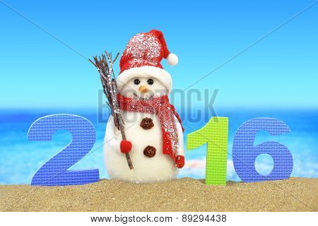 New year number 2016 and snowman on the beach